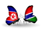 Butterflies with North Korea and Gambia flags on wings — Photo