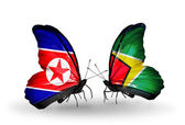 Butterflies with North Korea and Guyana flags on wings — Stock Photo