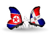 Butterflies with North Korea and Dominicana flags on wings — Stock Photo