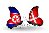 Butterflies with North Korea and Denmark flags on wings — Photo