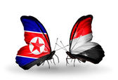 Butterflies with North Korea and Yemen flags on wings — Stock Photo