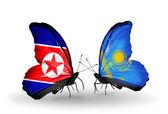 Butterflies with North Korea and Kazakhstan flags on wings — Stock Photo