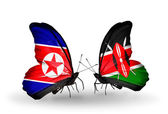 Butterflies with North Korea and Kenya flags on wings — Stock Photo