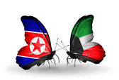 Butterflies with North Korea and Kuwait flags on wings — Stock Photo