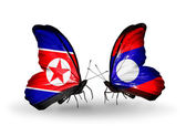 Butterflies with North Korea and Laos flags on wings — Stock Photo