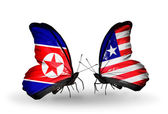 Butterflies with North Korea and Liberia flags on wings — Stock Photo