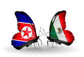 Butterflies with North Korea and Mexico flags on wings — Stock Photo