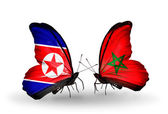 Butterflies with North Korea and Morocco flags on wings — Photo