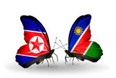 Butterflies with North Korea and Namibia flags on wings — Stock Photo