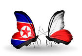 Butterflies with North Korea and Poland flags on wings — Photo
