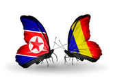 Butterflies with North Korea and Chad, Romania flags on wings — Photo