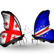 Butterflies with Georgia and Cape Verde islands flags on wings — Stock Photo