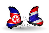 Butterflies with North Korea and Thailand flags on wings — Stock Photo