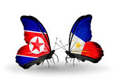 Butterflies with North Korea and Philippines flags on wings — Stock fotografie