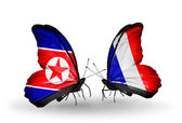 Butterflies with North Korea and France flags on wings — Stock Photo