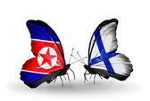 Butterflies with North Korea and Finland flags on wings — Stock Photo
