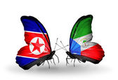 Butterflies with North Korea and Equatorial Guinea flags on wings — Stock Photo