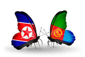 Butterflies with North Korea and Eritrea flags on wings — Stock Photo