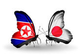 Butterflies with Georgia and Japan flags on wings — Stock Photo