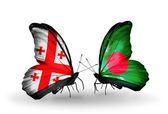 Farfalle con bandiere georgia e bangladesh sulle ali — Foto Stock