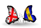 Butterflies with Georgia and Barbados flags on wings — Stock Photo