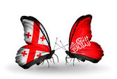 Butterflies with Georgia and Waziristan flags on wings — Stock Photo