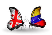 Butterflies with Georgia and Venezuela flags on wings — Stock Photo