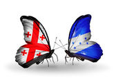 Butterflies with Georgia and Honduras flags on wings — Stock Photo