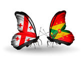 Butterflies with Georgia and Grenada islands flags on wings — Stock Photo