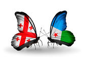 Butterflies with Georgia and Djibouti islands flags on wings — Stock Photo