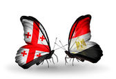 Butterflies with Georgia and Egypt islands flags on wings — Stock Photo