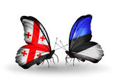 Butterflies with Georgia and Estonia islands flags on wings — Stock Photo