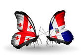 Butterflies with Georgia and Dominicana islands flags on wings — Stock Photo