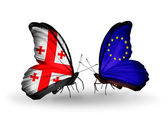 Butterflies with Georgia and European Union islands flags on wings — Stock Photo