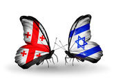 Butterflies with Georgia and Israel islands flags on wings — Stock Photo