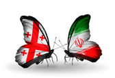 Butterflies with Georgia and Iran islands flags on wings — Stock Photo