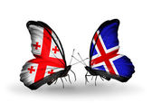 Butterflies with Georgia and Iceland islands flags on wings — Stock Photo