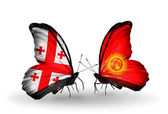 Butterflies with Georgia and Kirghiz islands flags on wings — Stock Photo