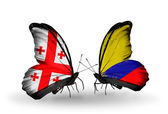 Butterflies with Georgia and Columbia islands flags on wings — Stock Photo