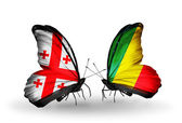 Butterflies with Georgia and Kongo islands flags on wings — Stock Photo