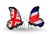 Butterflies with Georgia and Costa Rica islands flags on wings — Stock Photo