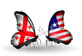 Butterflies with Georgia and Liberia islands flags on wings — Stock Photo