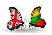 Butterflies with Georgia and Lithuania islands flags on wings — Stock Photo