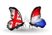 Butterflies with Georgia and Luxembourg islands flags on wings — Stock Photo