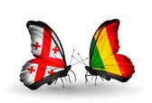 Butterflies with Georgia and Mali islands flags on wings — Stock Photo