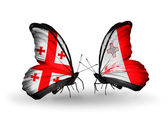 Butterflies with Georgia and Malta islands flags on wings — Stock Photo