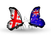 Butterflies with Georgia and New Zealand flags on wings — Stock Photo