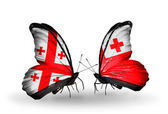 Butterflies with Georgia and Tonga flags on wings — Stock Photo