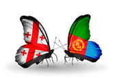 Butterflies with Georgia and Eritrea flags on wings — Stock Photo
