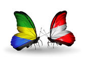 Butterflies with Gabon and  Austria flags on wings — Stock Photo